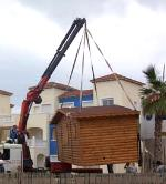 Photo of Swiss Chalet club room at Torrema Natura being lowered into position